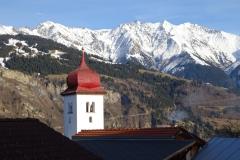 Kirchturm Luven und die Signina-Gruppe